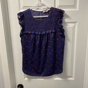 Blue shirt with ruffle sleeves.